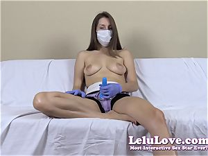 stripped to the waist girl with medical mask and strap on dildo