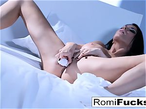 Solo fun on the bed with the buxom porn industry star Romi Rain