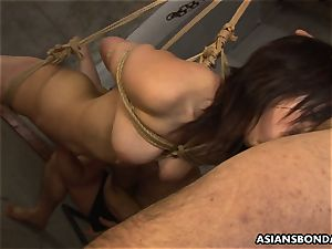 trussed up to a cable and throating on the fellas