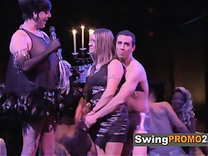 Macho husband takes his wifey out to a nightclub with other swingers