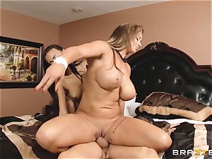 Eva Notty demonstrates her stepdaughter Janice Griffith how to sate a pipe
